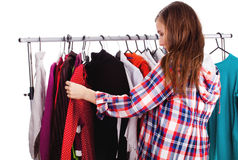 Teen girl choosing her clothes Royalty Free Stock Photography