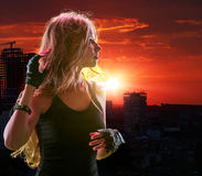 Teen girl in city looking sunset Stock Photography
