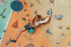Teen girl climbing in gym Royalty Free Stock Photography