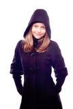Teen girl in coat posing Stock Photography