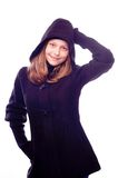 Teen girl in coat posing Stock Photos