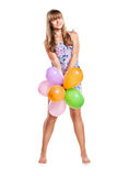 Teen girl with colorful ballons Stock Photography