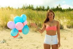 Teen girl with colorful balloons outside Royalty Free Stock Photo