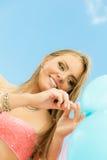 Teen girl with colorful balloons Stock Photos