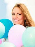 Teen girl with colorful balloons Royalty Free Stock Photography