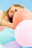 Teen girl with colorful balloons Stock Image