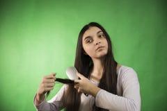 Teen girl comb hair Stock Photo