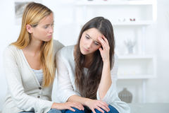 Teen girl consoling sad friend. Teen girl consoling her sad friend Royalty Free Stock Photo