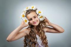 Teen girl corrects glasses Royalty Free Stock Photo