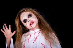 Teen girl in costume  on zombie. Royalty Free Stock Photo