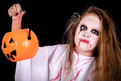 Teen girl in costume  on zombie. Royalty Free Stock Images