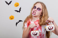 Teen girl in costume zombie. Royalty Free Stock Images