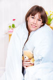 Teen girl covered with blanket Stock Image