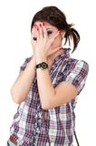 Teen girl covering her eye Stock Image