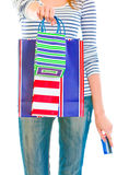 Teen girl with credit card giving shopping bags Royalty Free Stock Image
