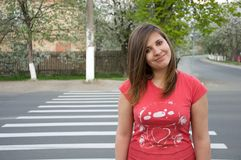 Teen girl crossing the road Royalty Free Stock Photos