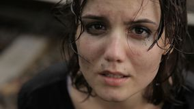 Teen girl crying in the rain stock video footage