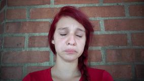 Teen Girl Crying And Tearing. Stock video in 4k or HD resolution stock footage