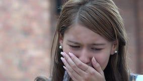 Teen Girl Crying. A young female hispanic teen Royalty Free Stock Photos