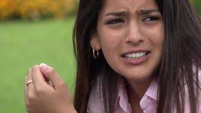Teen girl crying. A young teen hispanic female stock footage