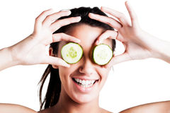 A Teen girl with cucumbers on eyes Stock Images
