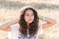 Teen girl with curly dark hair on  nature Royalty Free Stock Photography