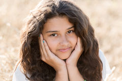 Teen girl with curly dark hair on  nature Royalty Free Stock Photos