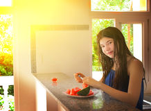 Teen girl cut water melon Stock Photos