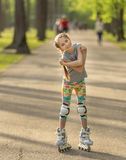 Teen girl with cute hairstyle skating Stock Image