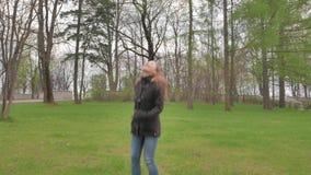 Teen girl dancing in a park. 4K UHD. stock video