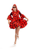 Teen girl dancing in a red polka-dot dress with sunglasses Royalty Free Stock Photography