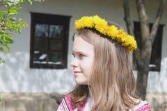 Teen Girl in dandelion wreath – close up portrait Stock Image
