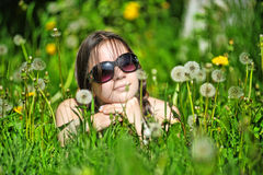 Teen girl  among dandelions Stock Photography