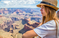 Teen girl in deep thought overlooking a canyon Royalty Free Stock Photos