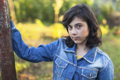 Teen girl in denim jacket portrait outdoors. Stock Images