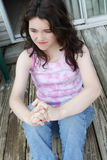 Teen girl depressed sad day dreaming stock photo