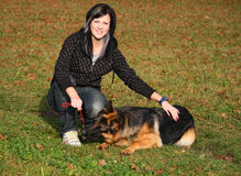 Teen girl with dog. Young German shepherd dog is playing with the teen girl royalty free stock photography