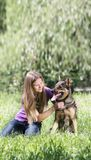 Teen girl with dog. Outdoors Royalty Free Stock Photography