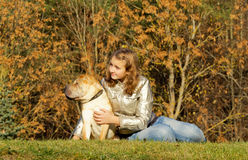 Teen girl with dog Stock Photography