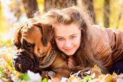 Teen girl and dog Royalty Free Stock Photos