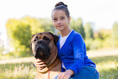 Teen girl with the dog Royalty Free Stock Image
