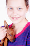 Teen girl with dog in her hands, closeup Stock Images