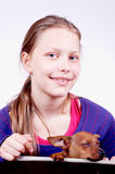 Teen girl with dog in her hands, closeup Stock Image