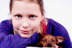 Teen girl with dog in her hands, closeup Stock Photo