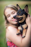 Teen girl and dog Stock Photography