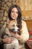 Teen girl with a dog Royalty Free Stock Photos