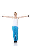 Teen girl doing exercises. Royalty Free Stock Photo