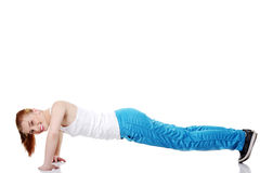Teen girl doing exercises on the floor. Stock Photos