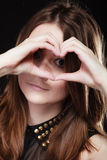 Teen girl doing heart shape love symbol with hands Stock Photo