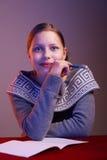 Teen girl doing her homework Royalty Free Stock Image